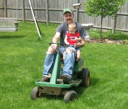 Dad and Ace Riding On The Mower