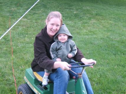 Momma and Ace On The John Deere