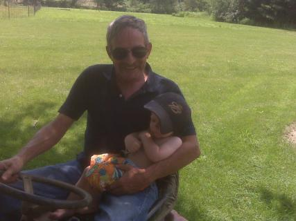 Grandpa and Ace Riding On The Mower