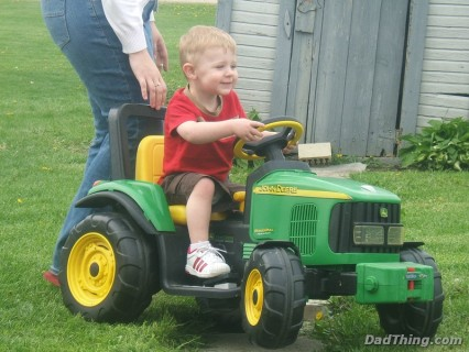 Ace Cruising On His John Deere Mower