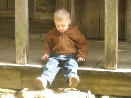 Sitting On The Front Porch Of An 1800's Cabin